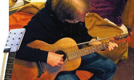The Thumb-buster Harp Guitar